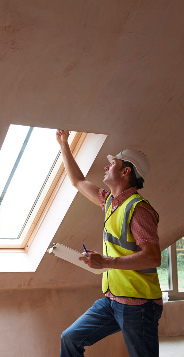 Man Inspecting New House